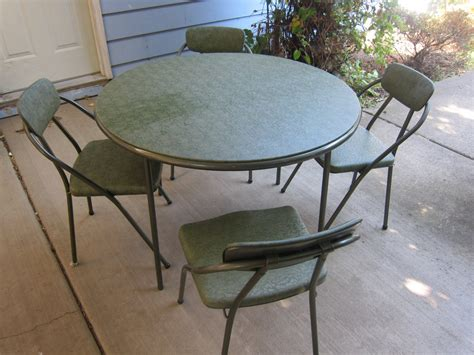 1950 s cosco folding table and 4 chairs vinyl tubular