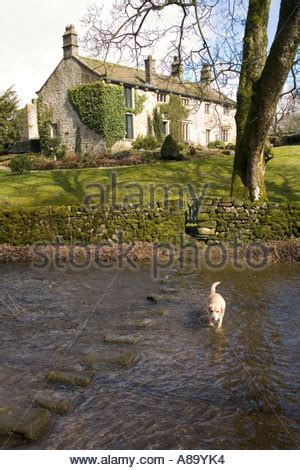 beautiful winter stepping stones sherbrook valley 785 | uk yorkshire wharfedale linton village cottage at linton beck stepping a89yk4