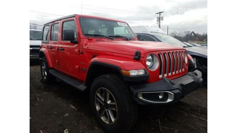 jeep wrangler unlimited sahara  sale aed  red