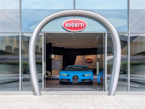 A key design feature is the 13 feet tall horseshoe shaped entrance which invites guests it's quite obvious why dubai trumped cities like monaco and los angeles for the biggest bugatti showroom in the world. Dubai gets world's largest Bugatti showroom - Autodevot