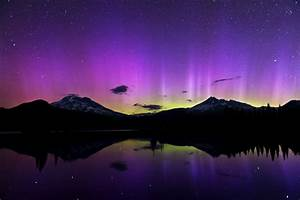 Shimmering purple aurora after a powerful solar storm ...