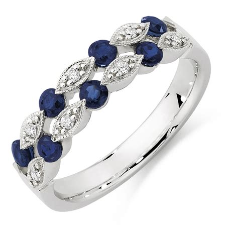 white gold emerald ring ring with sapphire diamonds in 10kt white gold