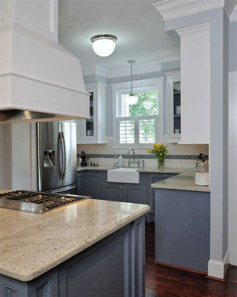 blue and white kitchen cabinets white upper cabinets dark grey lower cabinets grey blue