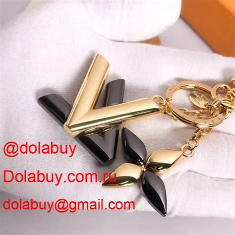 louis vuitton twist bag charm  goldsilvery