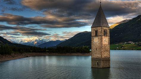wallpaper lake resia italy europe mountain nature