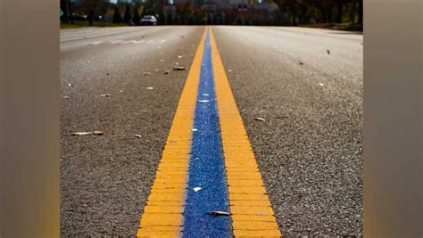'Thin Blue Line' painted between yellow lane dividers to ...