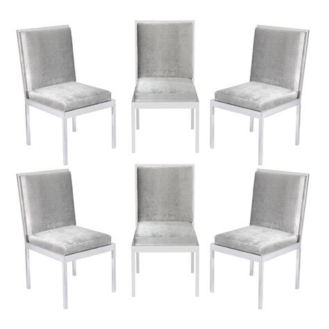 set of six dining chairs in polished chrome by milo