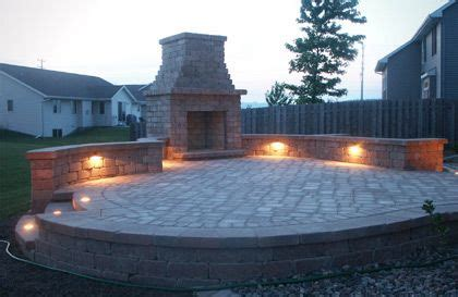 raised patio area with retaining wall and fireplace wish my home looked liked i can dream