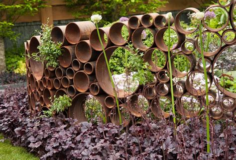 Rusty Garden Sculpture Made From Sections Of Steel Pipe