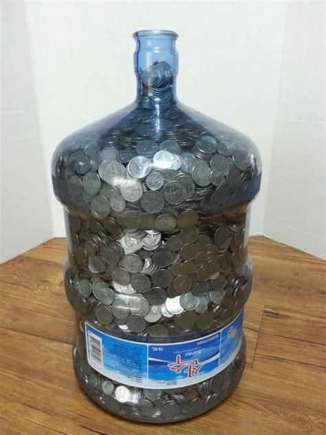 money   gallon water jug holds