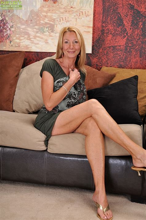 Older Lady Pam Roberts Pulling Down Yellow Underwear And