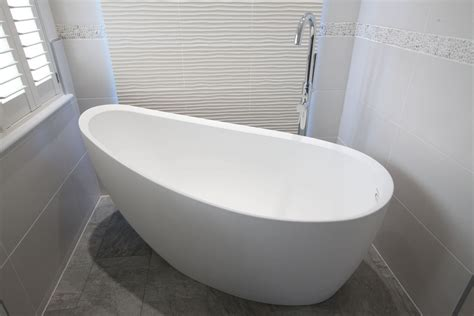 kohler tub modern bathroom with white freestanding tub and