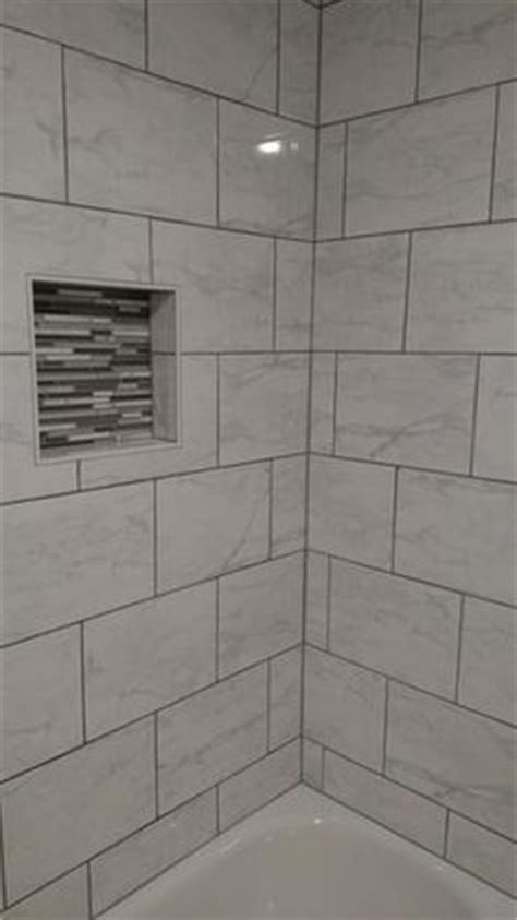 smokey topaz master shower and subway tiles on