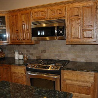 light colored oak cabinets with granite countertop