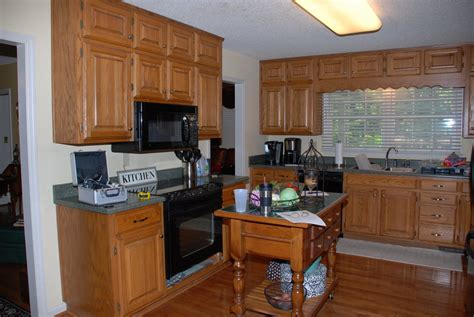 updating oak kitchen cabinets before and after remodelaholic from oak kitchen cabinets to painted white