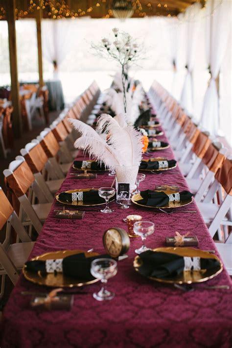 burgundy black  gold steampunk reception decor