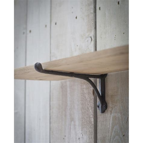 Cast Iron Brackets and Raw Oak Shelf Furnish Every Season