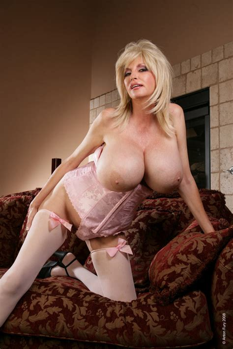 Busty Blonde Dee Dee Deluxx Shows Off Her Huge Boobs