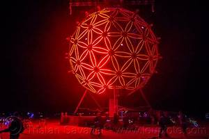 burning man, giant glowing red ball