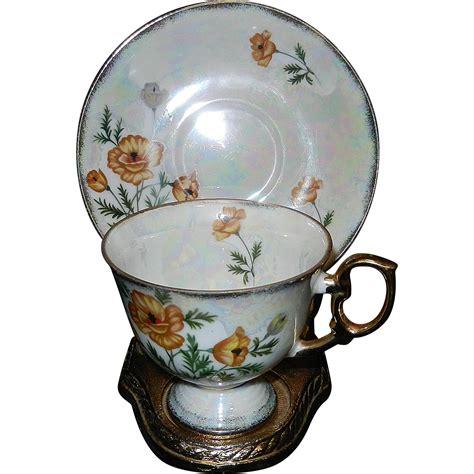 dinnerware tea orange poppy ucagco china iridescent tea cup and saucer august orange