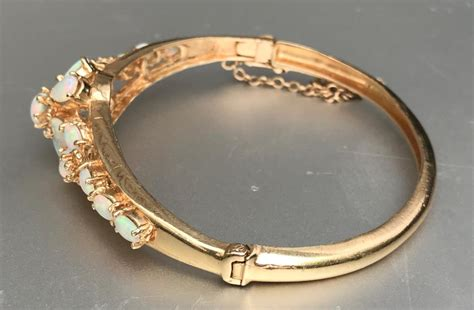Vintage Gorgeous! Estate 14k Yellow Gold Opal Floral. Baby Gold Bangle Bracelet. Coat Brooch. Simple Gold Wedding Band. Triple Rings. Small Gold Lockets. New Wedding Rings. Gold Bangle Bracelet Set. 14k White Gold Wedding Band For Her