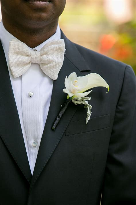 ivory orchid  calla lily boutonniere