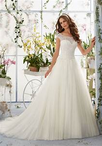 Embroidered lace overlays the bateau bodice on soft net for Embroidered wedding dress