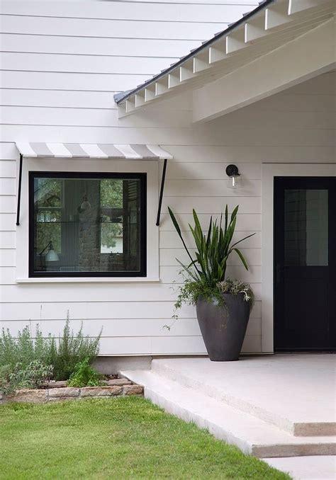 modern farm house  tim cuppett architects white exterior black windows  doors