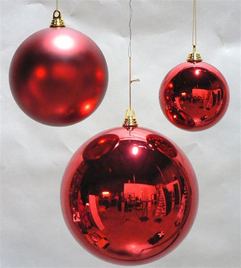 one large oversize red christmas ball plastic shiny 200mm
