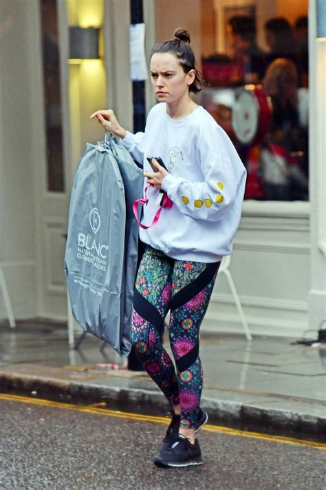 daisy ridley wears  white sweatshirt  colorful leggings  picking   dry cleaning