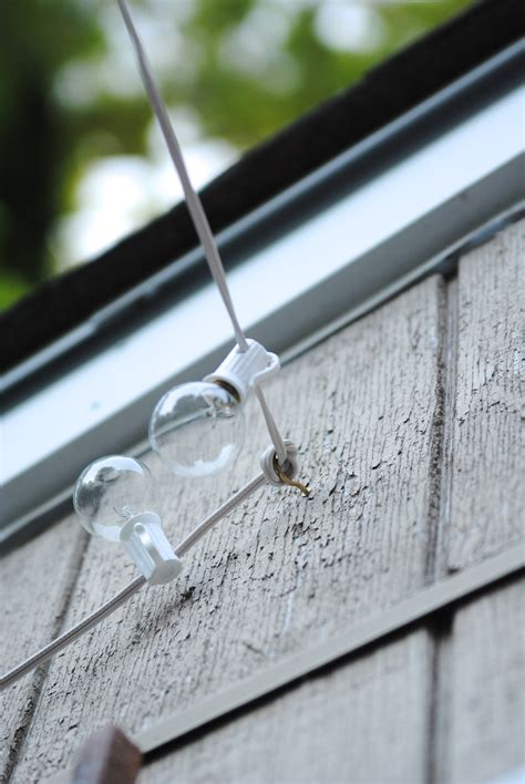 how to hang string lights on fence how to hang outdoor string lights the deck diaries part