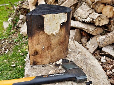 charred  log stand roland rolson
