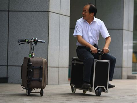 chinese inventor    suitcase scooter abc news