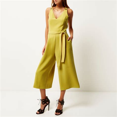 womens yellow jumpsuit river island yellow culotte jumpsuit in yellow lyst