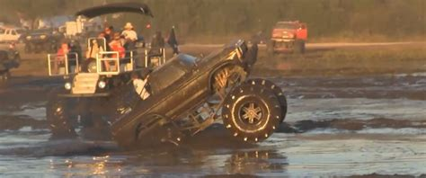monster truck mud videos monster truck doing wheelstands in mud is redneck stunt