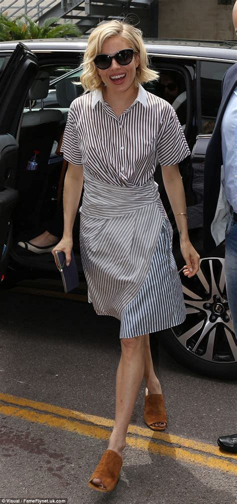 sienna miller puts  legs  show   striped wrapover