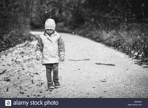 Walking Alone Black And White Stock Photos & Images