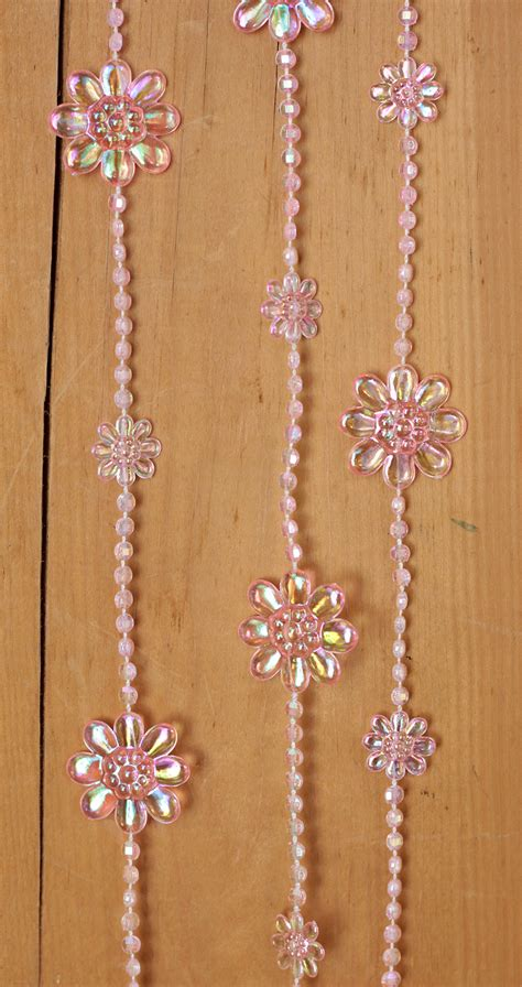 pink iridescent beaded garland with flowers by tj