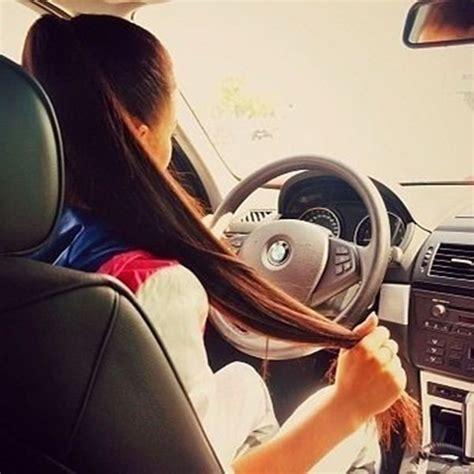 girl holding  hair  car