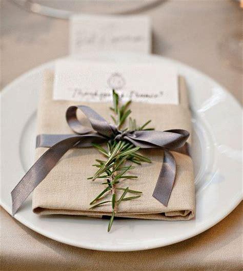 ribbon wrapped  napkin  place setting sprig
