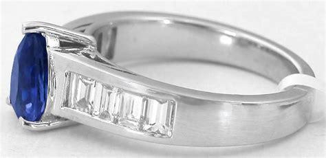pear shape sapphire  channel set baguette diamond ring