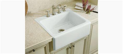 kohler alcott apron front sink alcott apron front kitchen sink with four faucet holes k