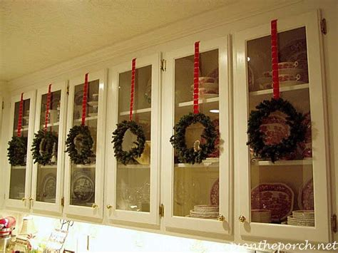 Decorate Cupboard Doors by Decorate Kitchen Cabinets With Preserved Boxwood Wreaths