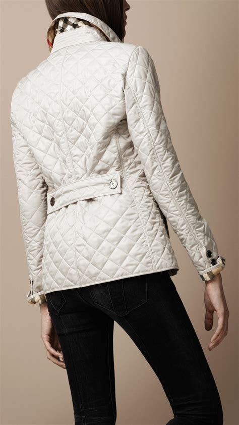 s burberry quilted jacket lyst burberry brit cinched waist quilted jacket in