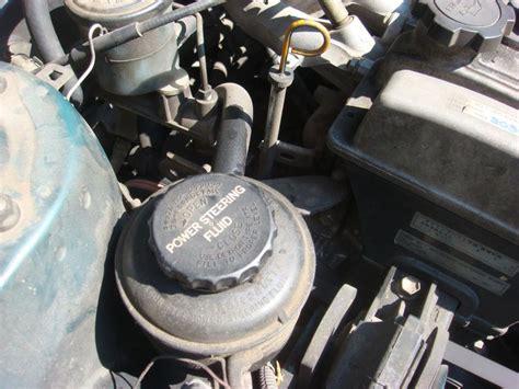 checking  filling power steering fluid