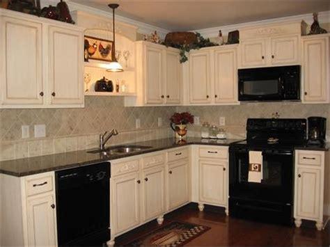 white cabinets  black appliances kitchen remodel