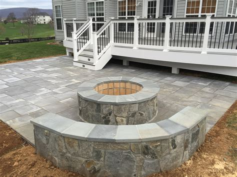 a beautiful paver patio with seating walls and a