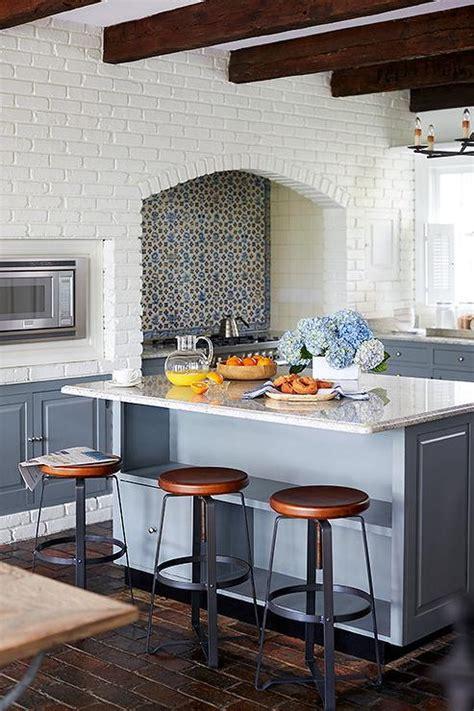 white kitchen walls white brick kitchen walls transitional kitchen 484 | steel gray kitchen island white brick wall round industrial counter stool
