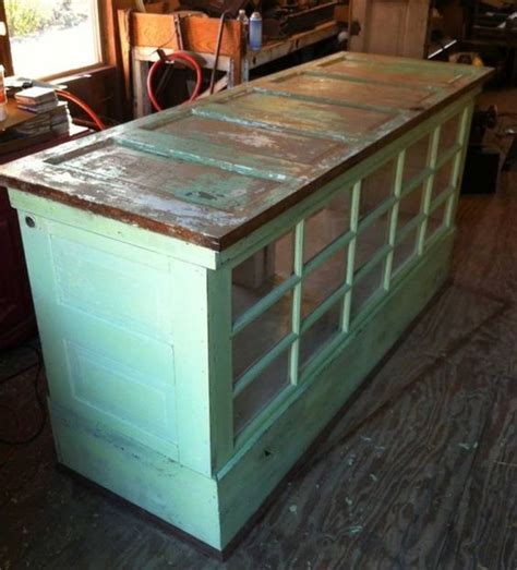 repurposed kitchen island ideas turn old doors into a kitchen island or cabinet these are awesome upcycled repurposed ideas