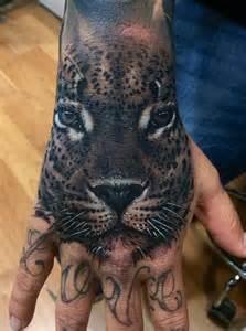 Leopard Hand Tattoo